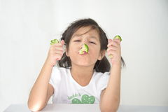 Cute girl eating boiled broccoli Stock Photography