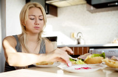 Cute girl eating brakfast Royalty Free Stock Photo