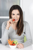 Cute girl eating healthy food Royalty Free Stock Photography
