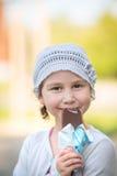 Cute girl eating ice-cream Stock Photos
