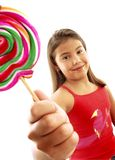 Cute girl eating lollipop Royalty Free Stock Images