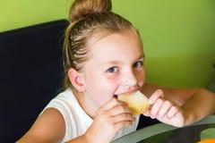 Cute girl eating melon Stock Photos
