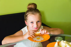 Cute girl eating melon. Photo of the cute girl eating melon Stock Image
