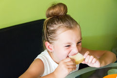 Cute girl eating melon. Photo of the cute girl eating melon Stock Photography