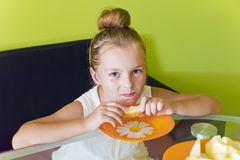 Cute girl eating melon. Photo of the cute girl eating melon Royalty Free Stock Photography