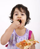 Cute girl eating pizza. Slice and enjoying Royalty Free Stock Images