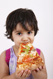 Cute girl eating pizza. Slice and enjoying Royalty Free Stock Image