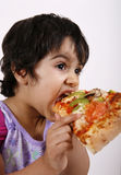 Cute girl eating pizza Stock Photo