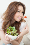 Cute girl eating Salad Stock Photo