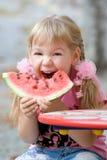 Cute girl eating watermelon. Stock Photos