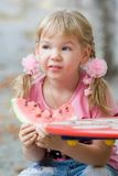 Cute girl eating watermelon. Royalty Free Stock Photo