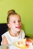 Cute girl eating watermelon and melon Stock Photos