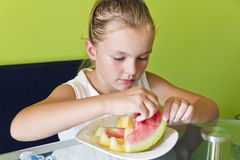 Cute girl eating watermelon and melon Royalty Free Stock Images