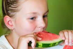 Cute girl eating watermelon Royalty Free Stock Image