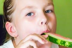 Cute girl eating watermelon Stock Photos