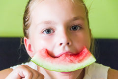 Cute girl eating watermelon Stock Photography