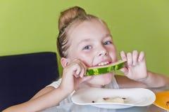 Cute girl eating watermelon Stock Photo