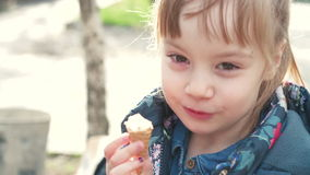 Cute girl eats a ice cream stock video footage