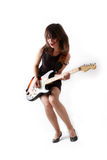 Cute girl with electric guitar Royalty Free Stock Photos