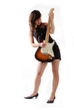 Cute girl with electric guitar Stock Photography
