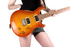 Cute girl with electric guitar. Isolated Royalty Free Stock Photo
