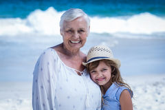 Cute girl embracing her grandmother Stock Photos
