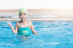 Cute girl enjoy to swimming Stock Images