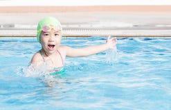 Cute girl enjoy to swimming Stock Image