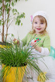 Girl enjoying green plants at spring Royalty Free Stock Photography
