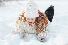 Cute girl enjoying nature on a winter walk in sunny day. Stock Photography