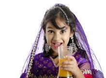 A cute girl enjoying orange juice Stock Image