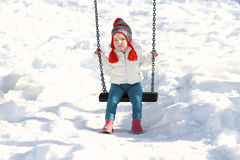Cute girl enjoying playground at winter stock photography