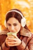Cute girl enjoying tea Royalty Free Stock Photography