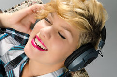 Cute girl enjoying to headphones Royalty Free Stock Images