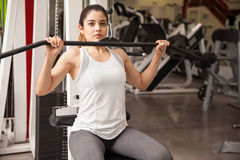 Cute girl exercising her back at the gym Royalty Free Stock Images