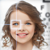 Cute girl with eye chart. Future technology, medicine and vision concept - cute girl with eye chart stock photos