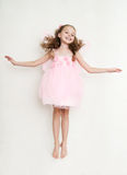 Cute girl in fairy costume jumping in the studio Royalty Free Stock Photography