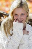 Cute girl in fall leaves Stock Images