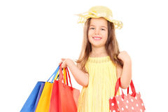 Cute girl in fancy clothes holding shopping bags Royalty Free Stock Photography