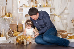 Cute girl and a father with Christmas presents royalty free stock photos