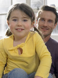 Cute Girl With Father Siting At Home Royalty Free Stock Images