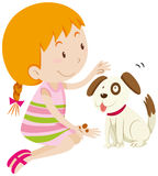 Cute girl feeding her pet dog Royalty Free Stock Images