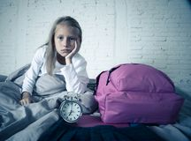 Cute girl feeling very tired early in the morning not wanting to get ready for school royalty free stock photo