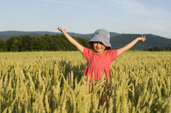 Cute girl on field Stock Images