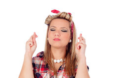 Cute girl with fingers crossed for wanting to be luckyin and pin Royalty Free Stock Photos