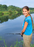 Cute girl fishing Royalty Free Stock Images