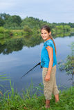 Cute girl fishing Royalty Free Stock Photo