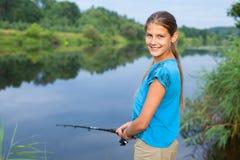 Cute girl fishing Stock Photography
