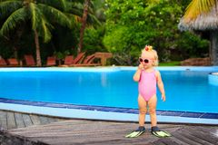 Cute girl with flippers in swimming pool at beach. Cute girl with flippers in swimming pool at tropical beach Royalty Free Stock Images