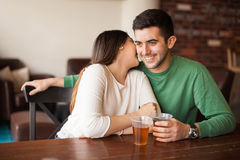 Free Cute Girl Flirting With A Guy At The Bar Stock Photography - 68073472